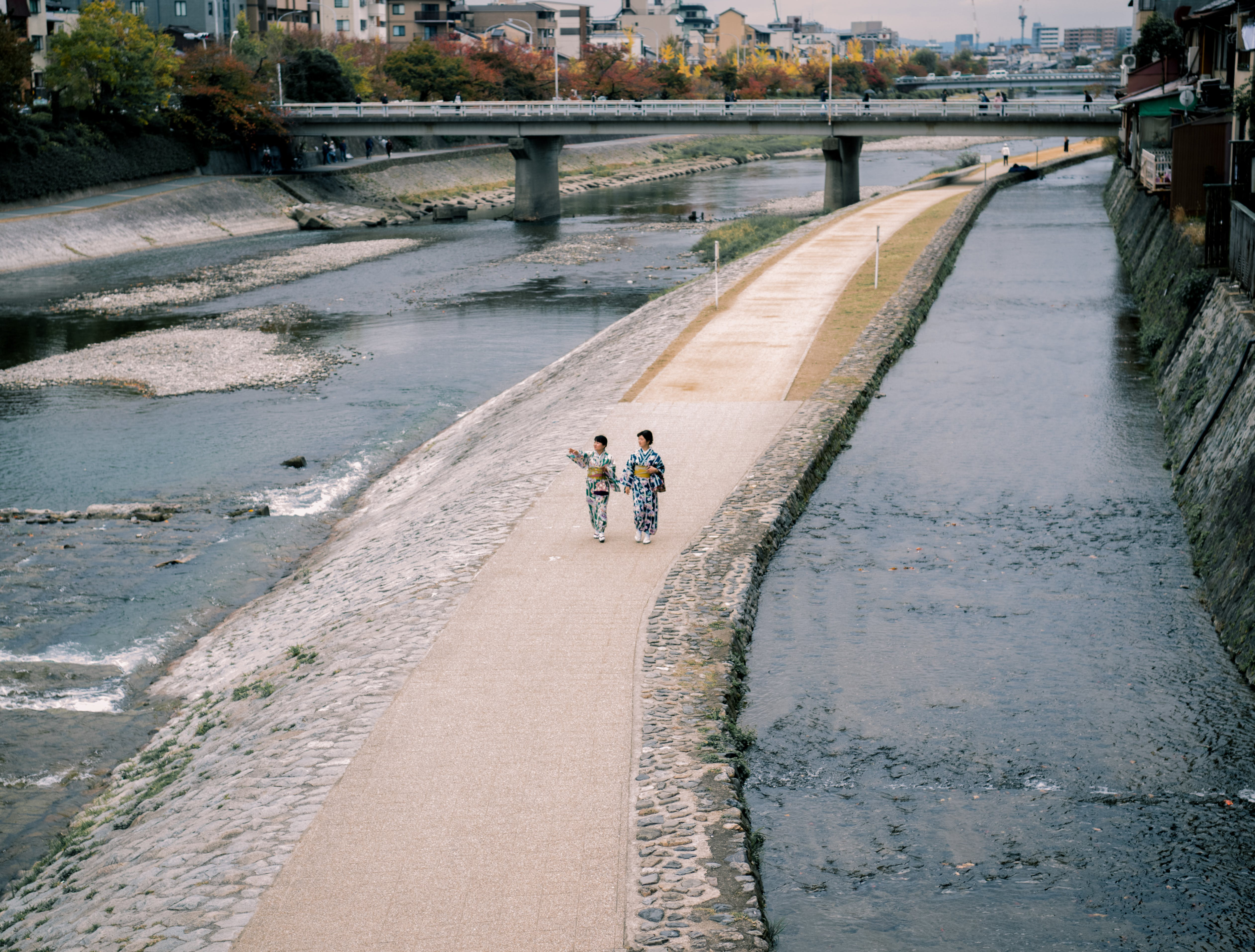 Aerial Photography of Two Women Walking on Pathway