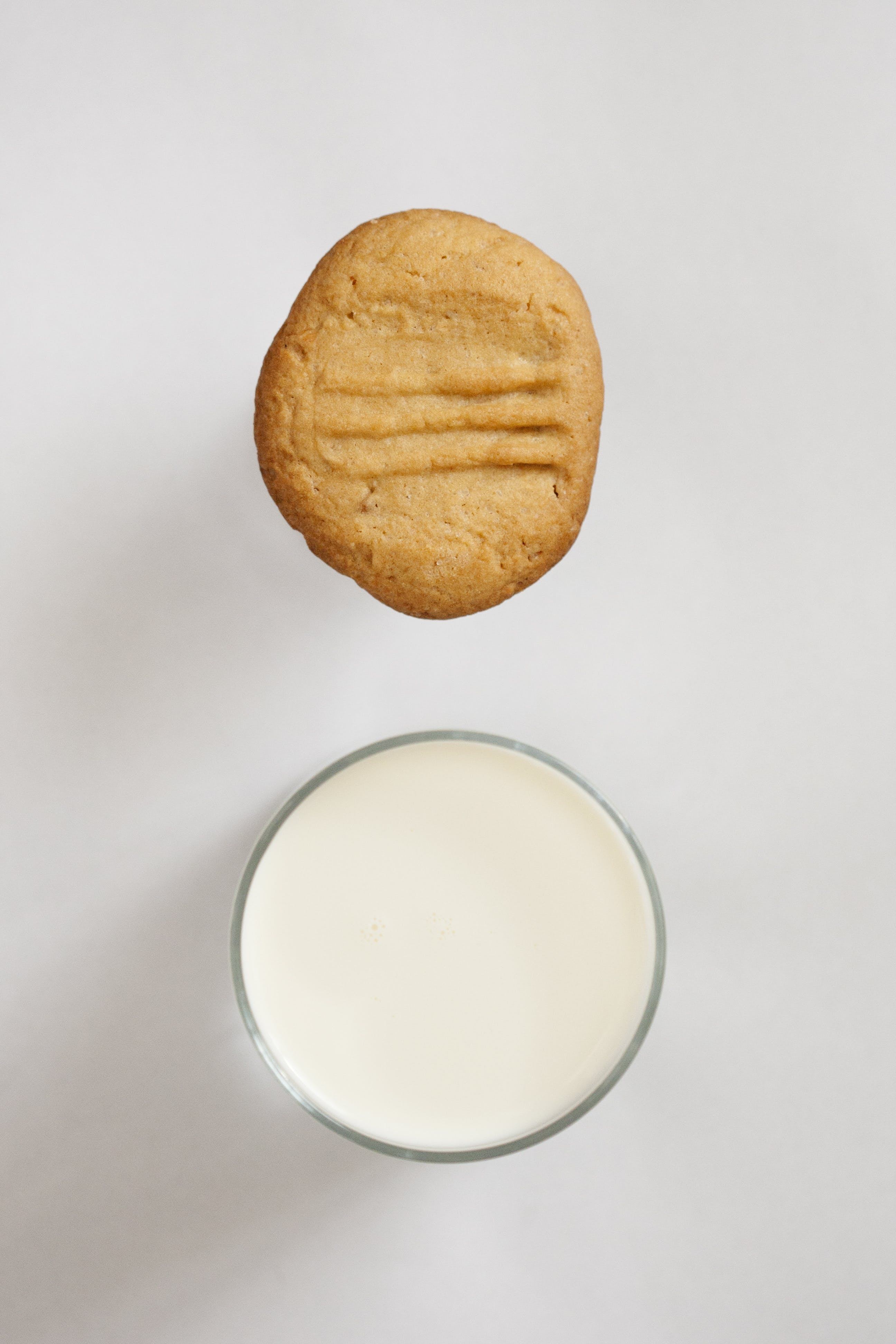Baked Cookie Near White Liquid in Cup