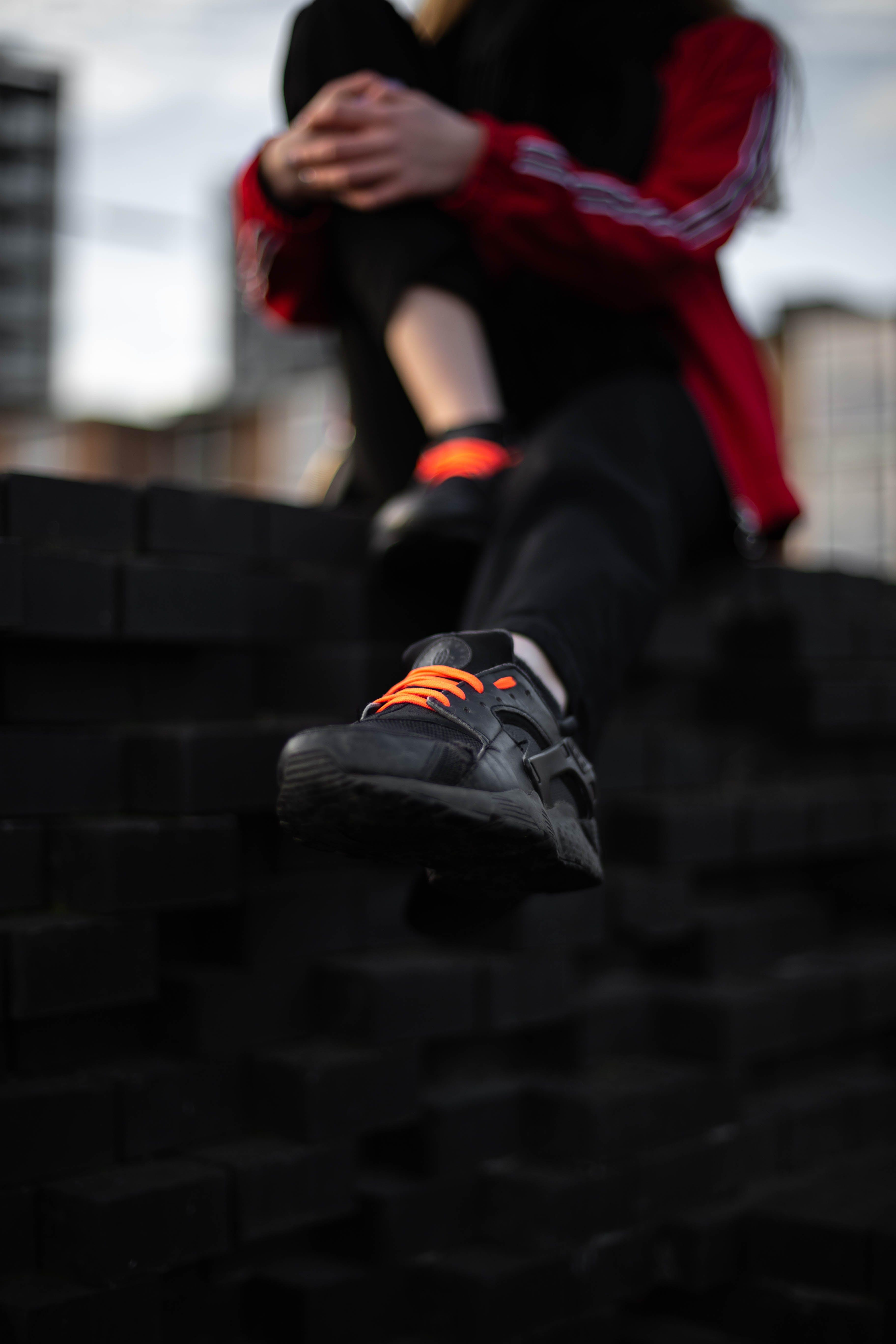 Person Wearing Black Nike Air Huarache Sneaker