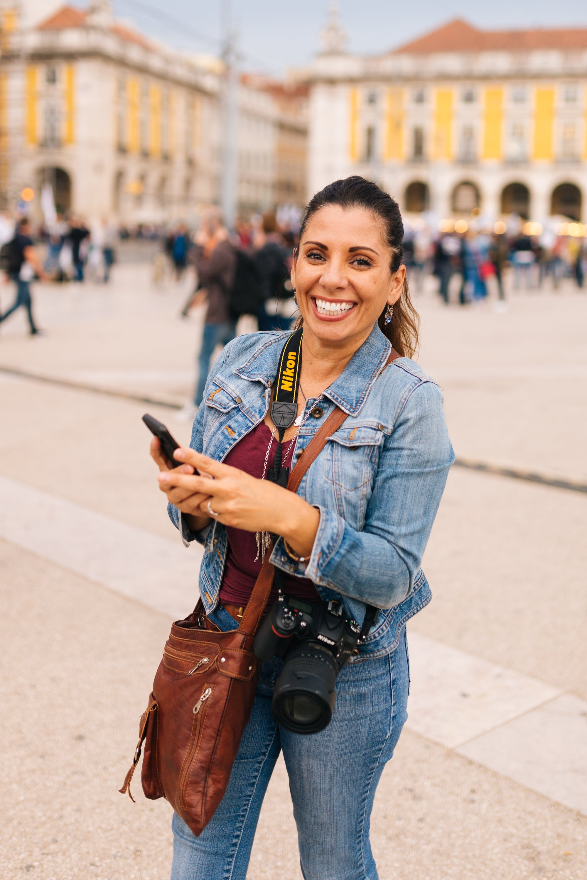 Smiling Woman Holding Smartphone Selective Focus Photography
