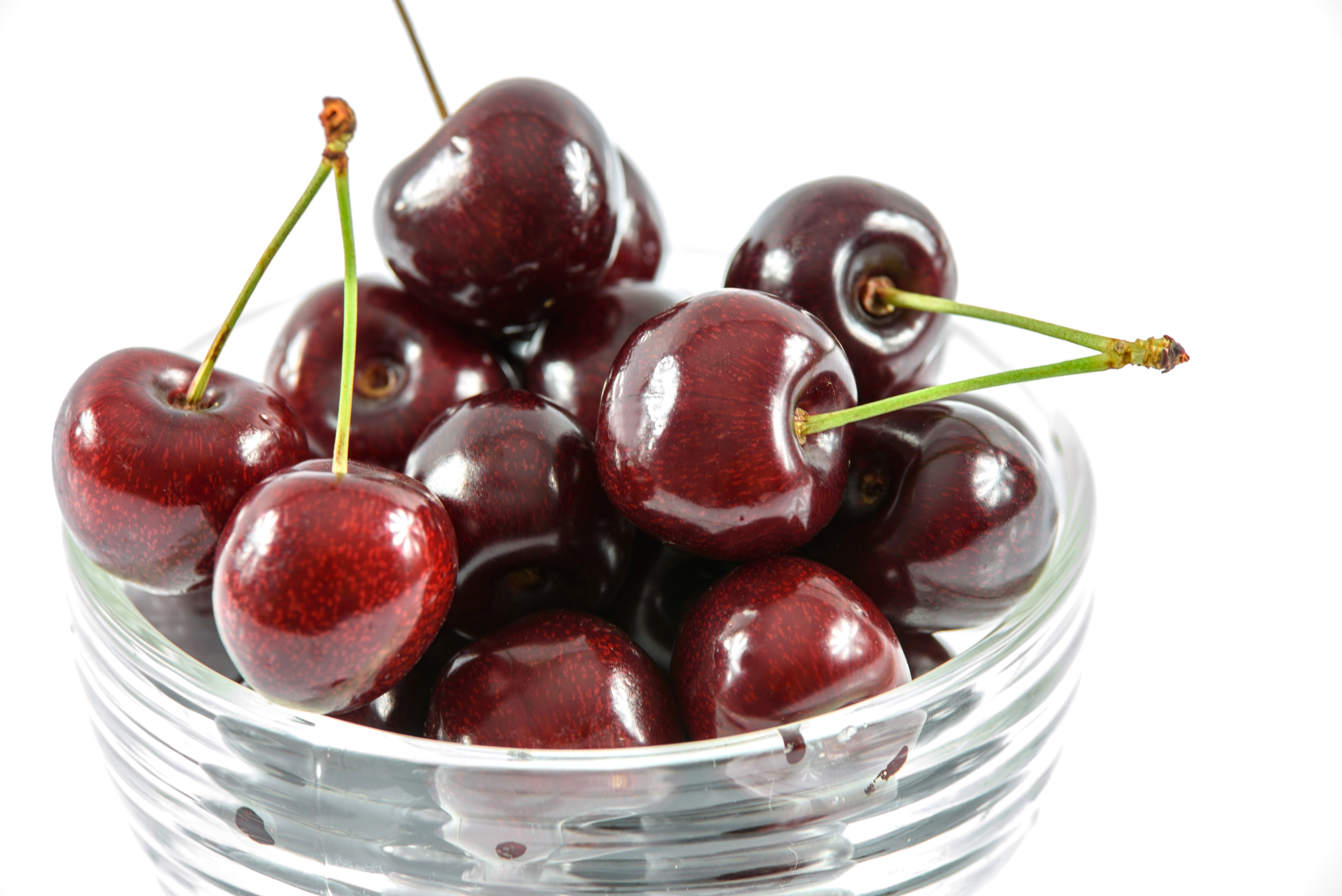 Red Cherry in Clear Glass Bowl