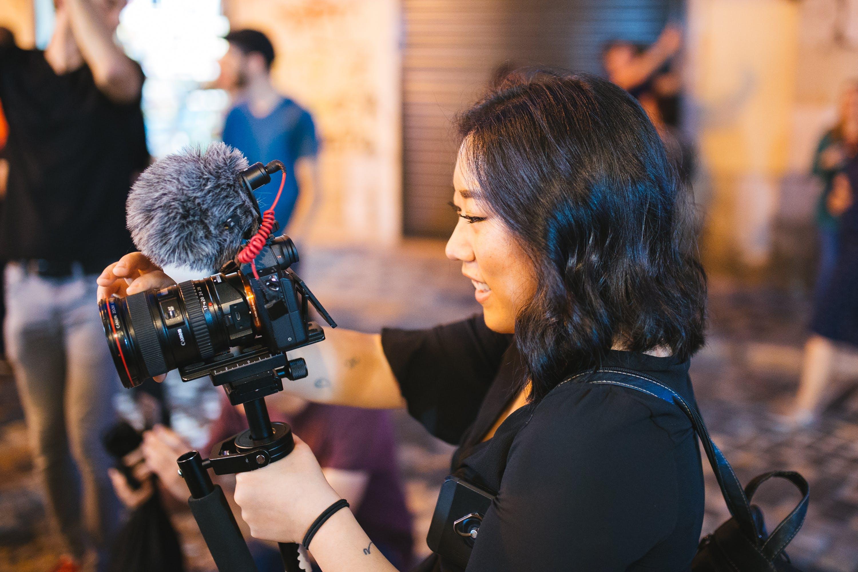 Smiling Woman Holding Black Dslr Camera