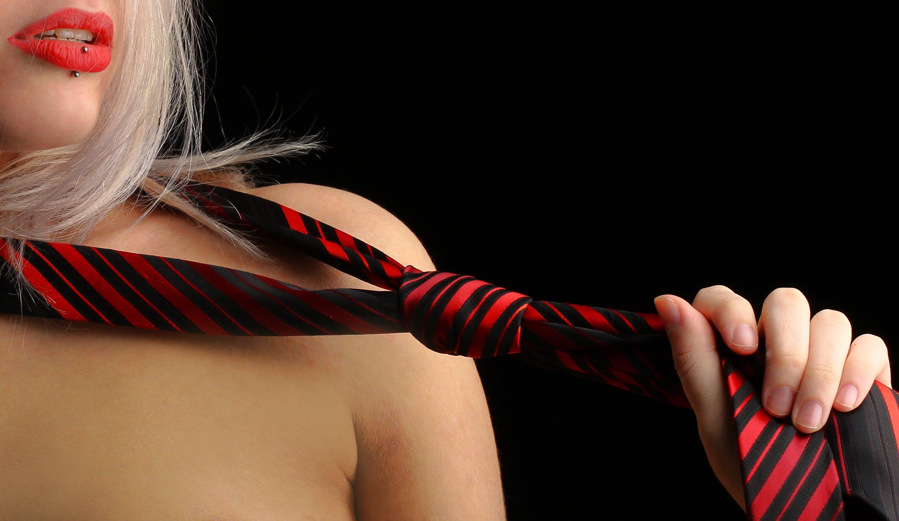 Woman Holding Necktie