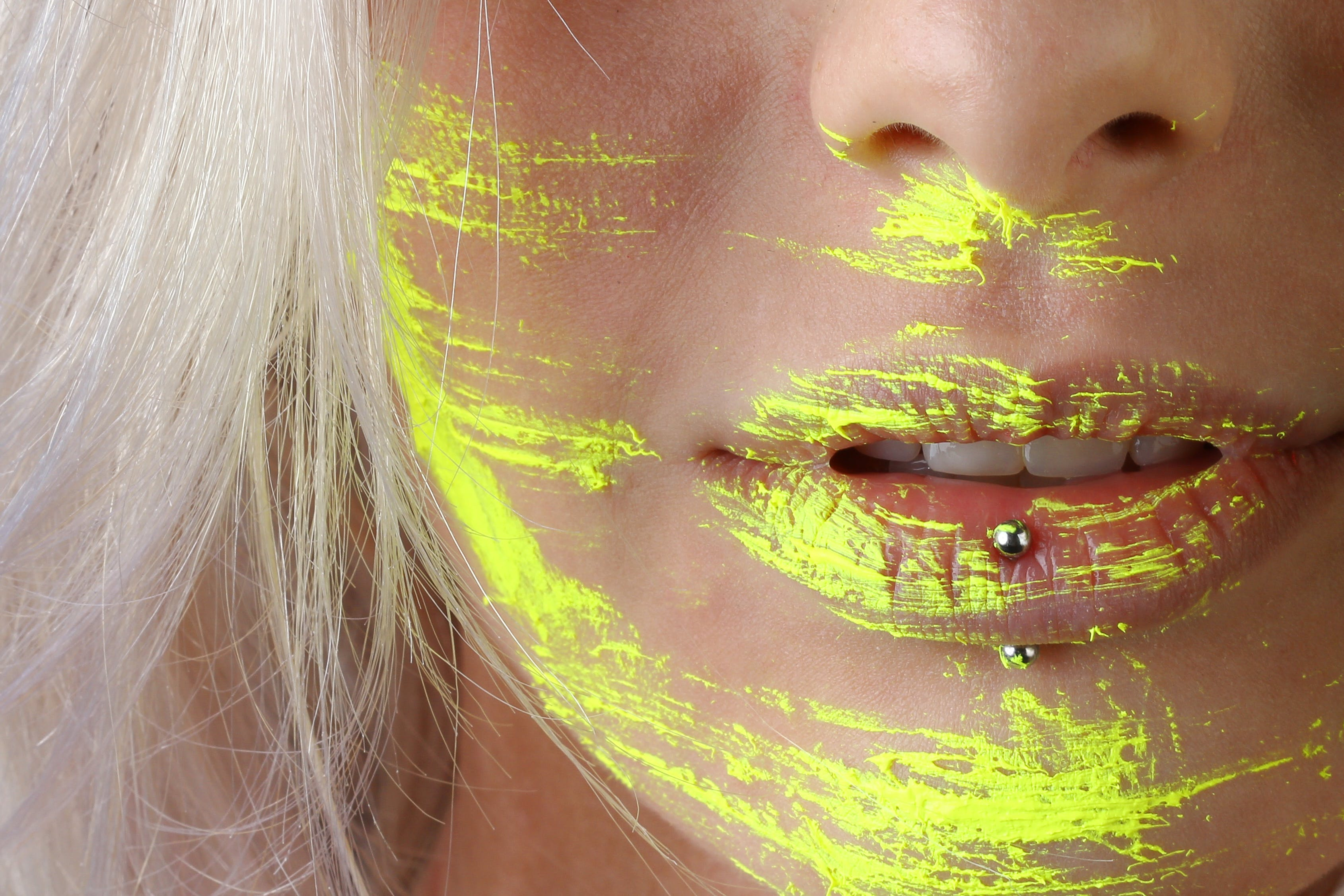 Woman With Yellow Paint On The Face