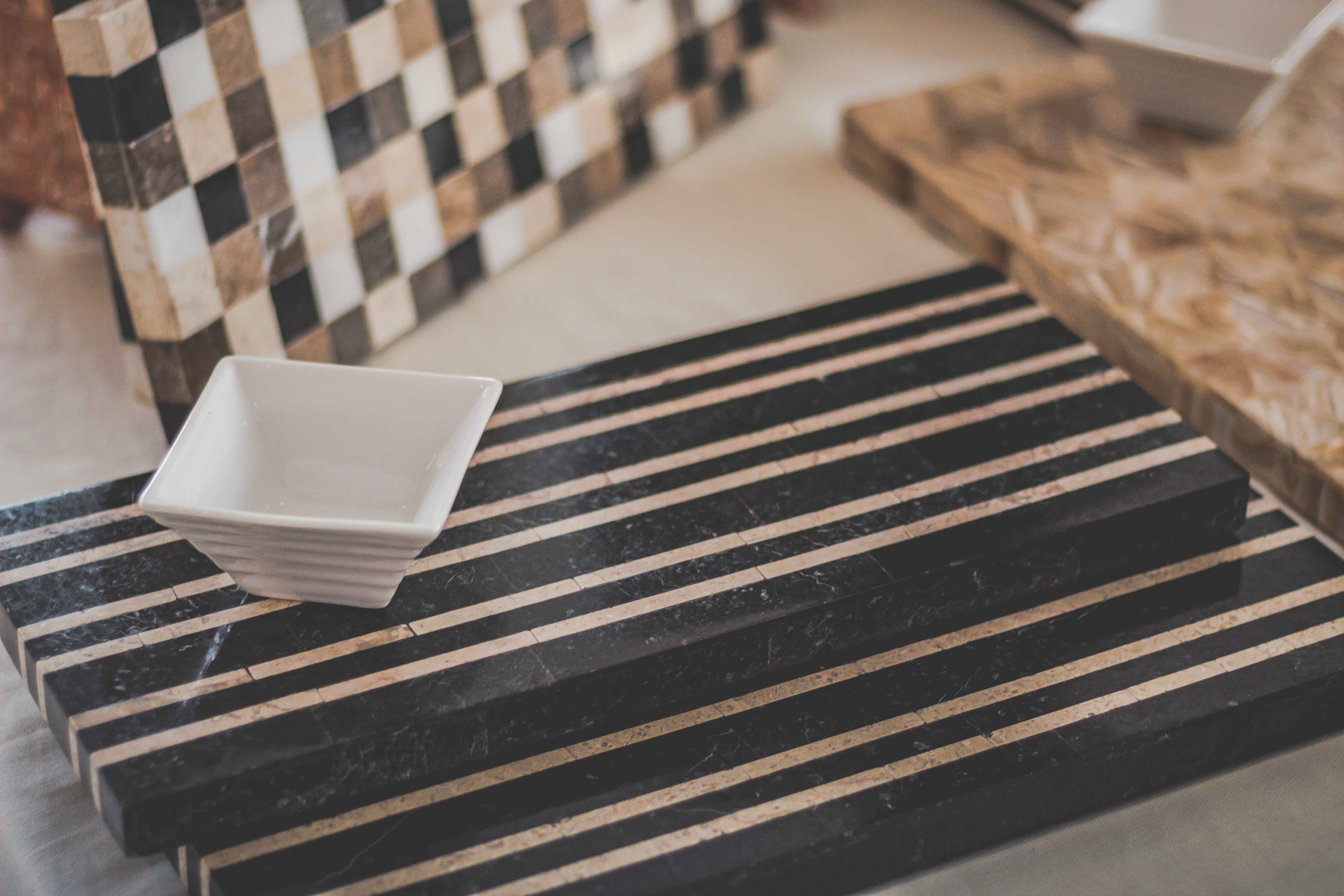 Square White Bowl and Black Wooden Surface