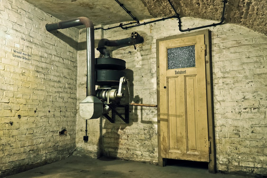 Black and Gray Metal Machine Inside a Room
