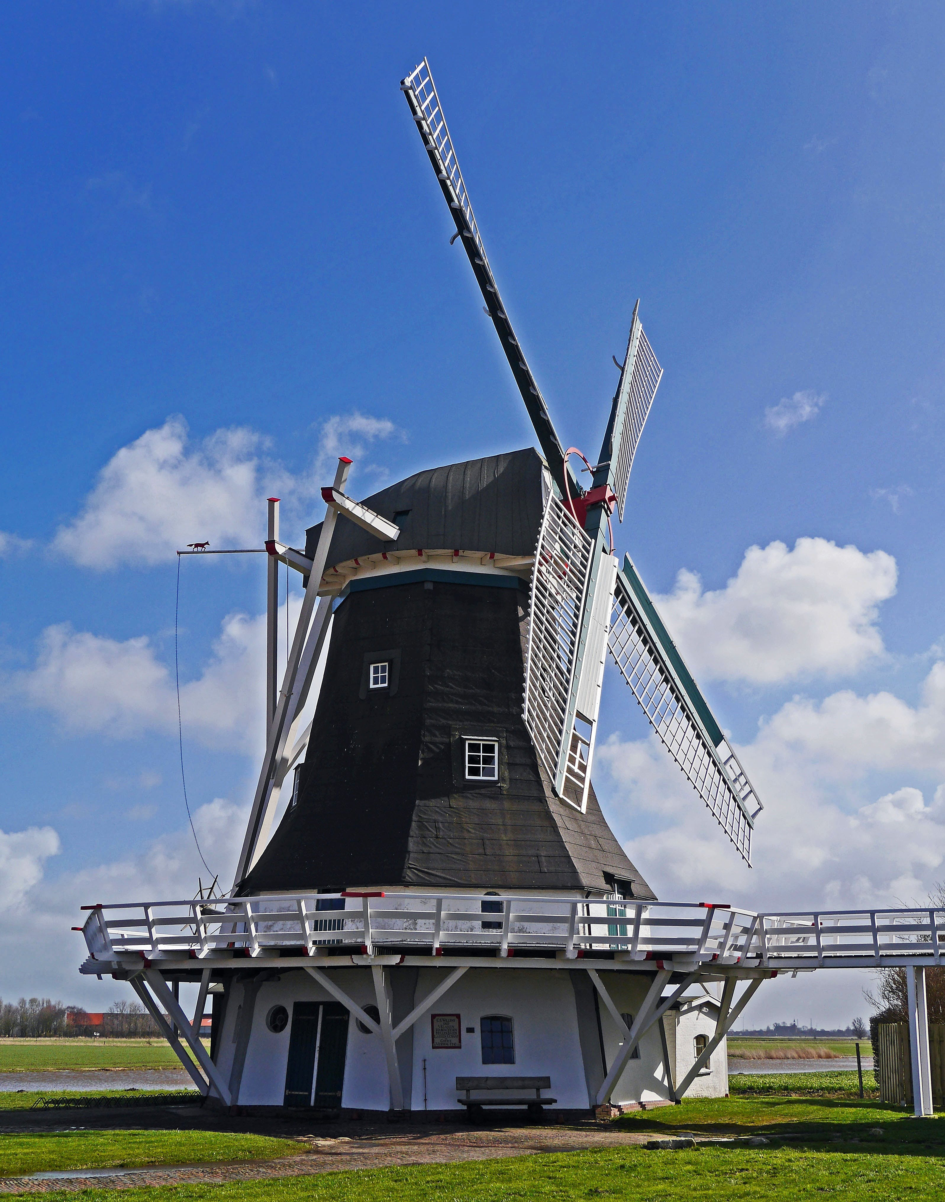 White and Black Wooden Windmill during Daytime