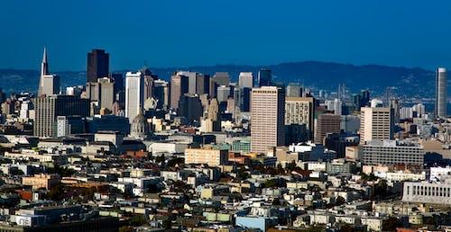 Foto profissional grátis de arquitetura, arranha-céus, casas, centro da cidade