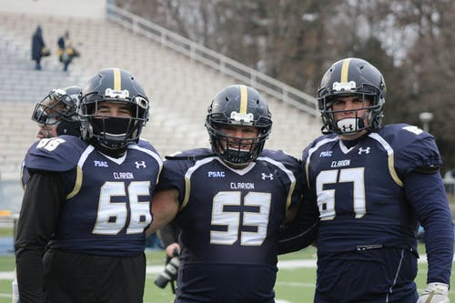 Three Football Players Having a Group Photo