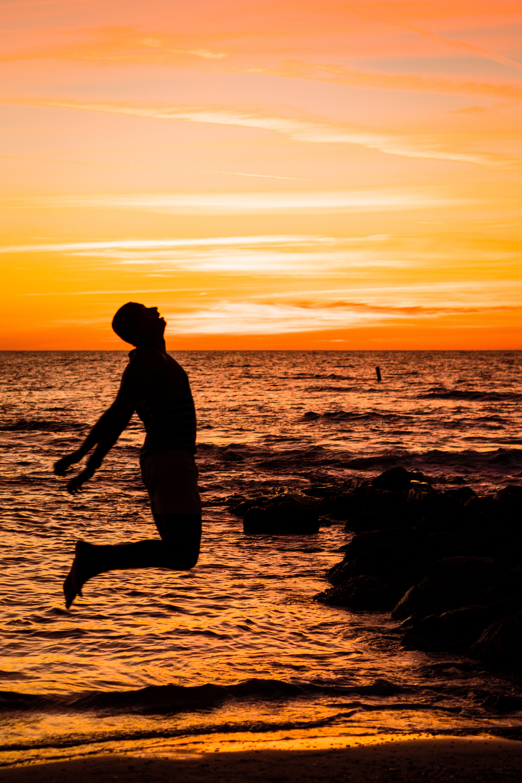 Man Jumping on Sea