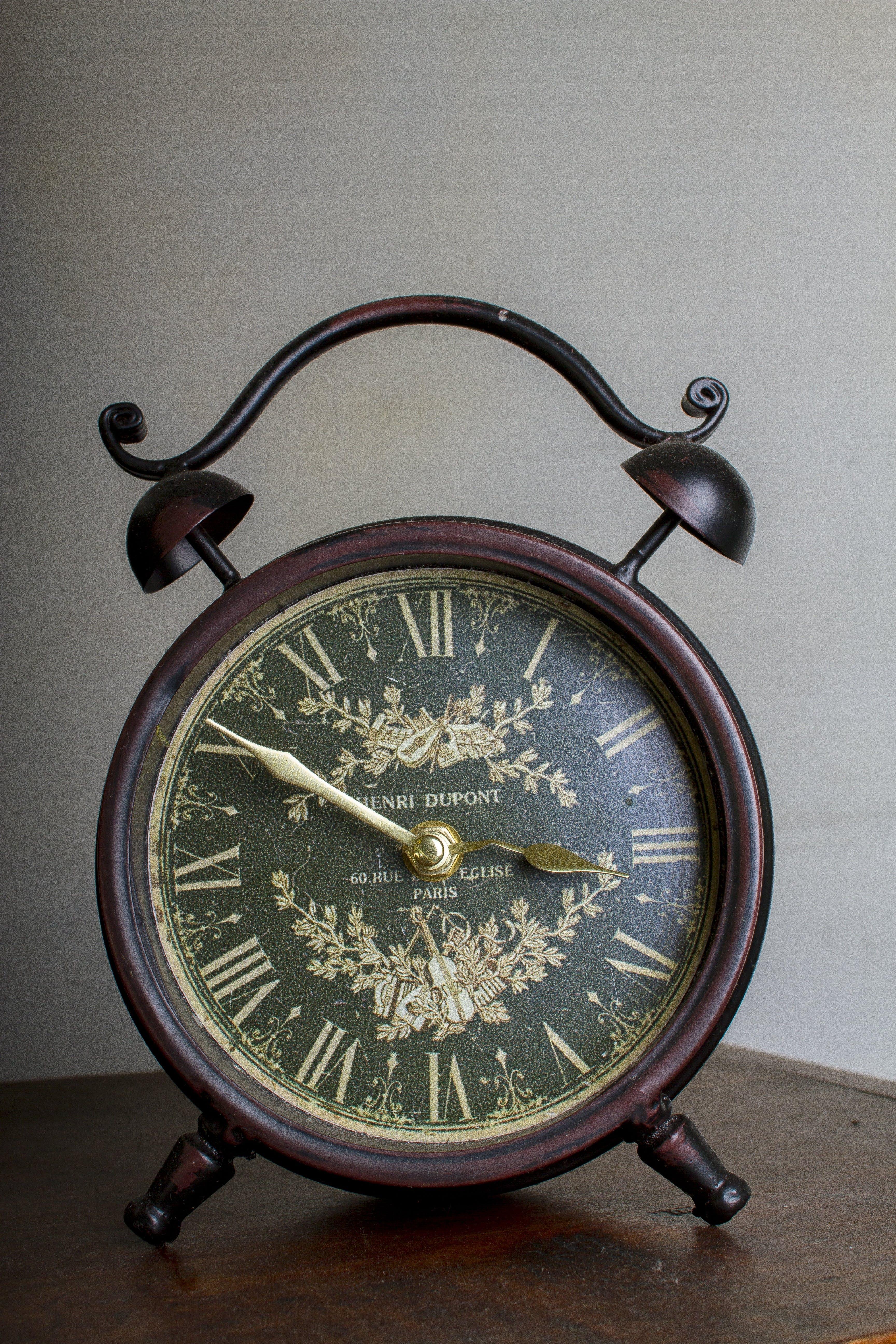 Brown Framed Alarm Clock on Brown Table