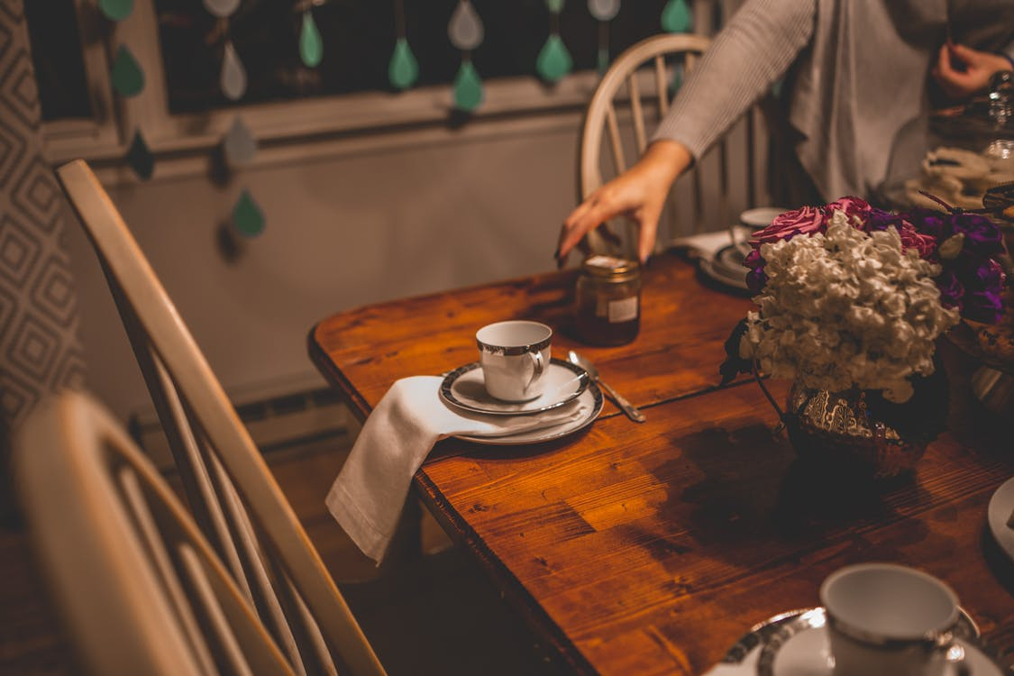 White Ceramic Teacup on Table