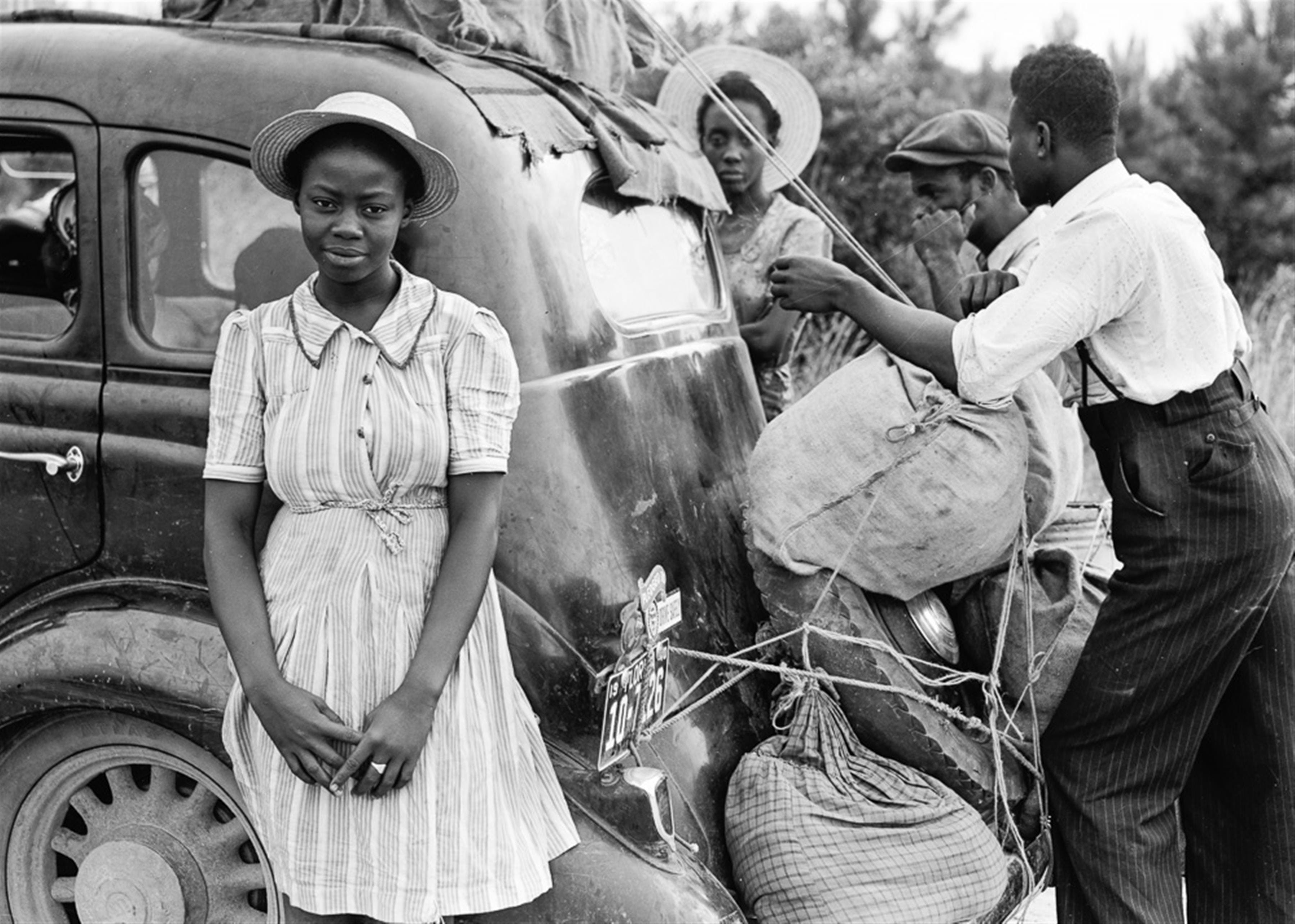 Woman in White Pinstripe Dress Near Black Vintage Car