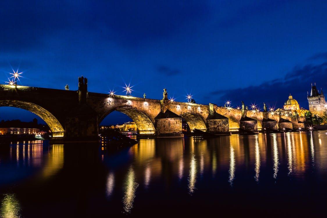 Brown and Black Concrete Bridge during Night