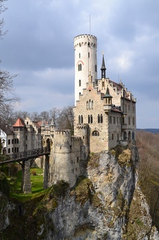 Gray and White Castle Built Near a Cliff