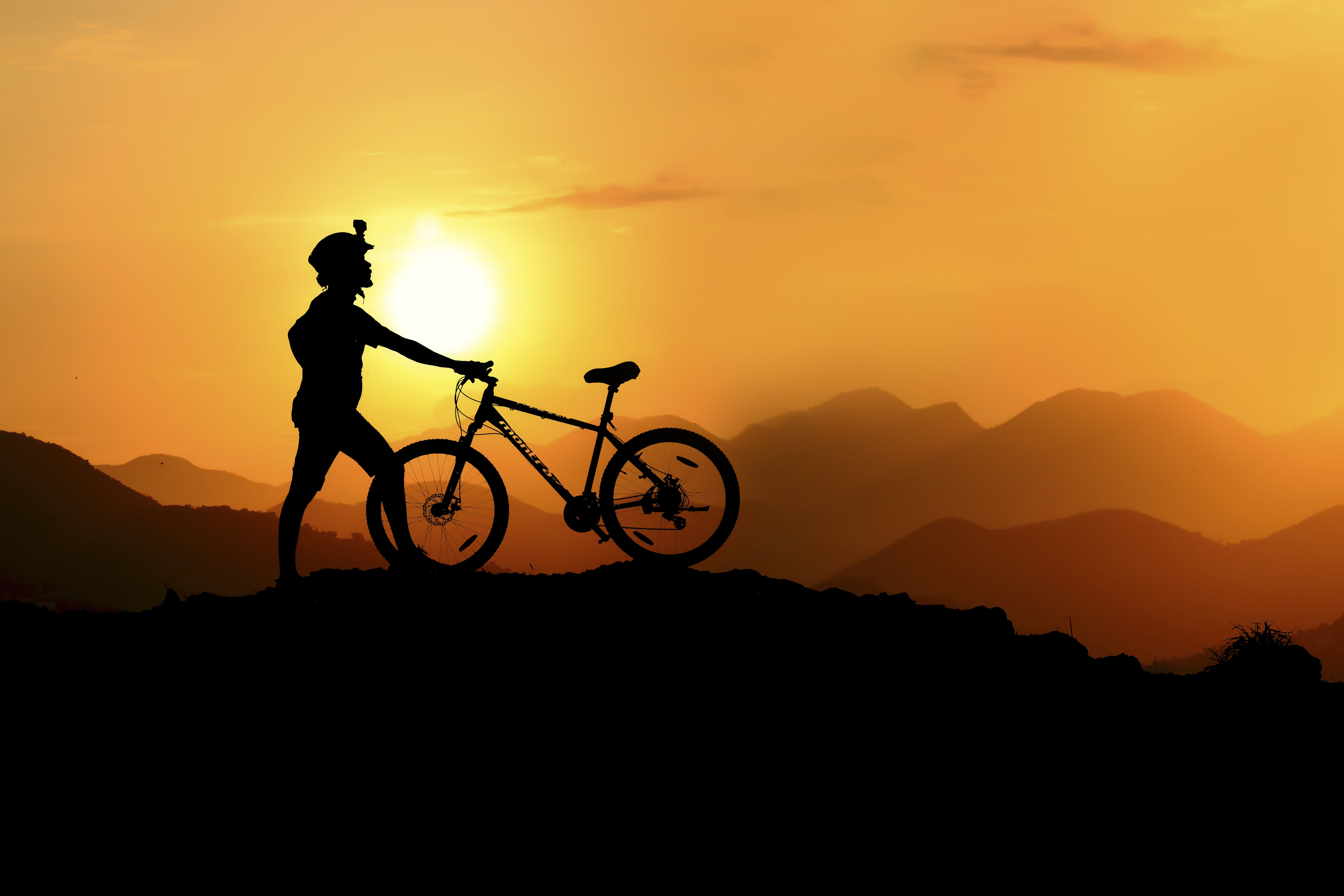 Silhouette Photography of Biker on Top of Hill