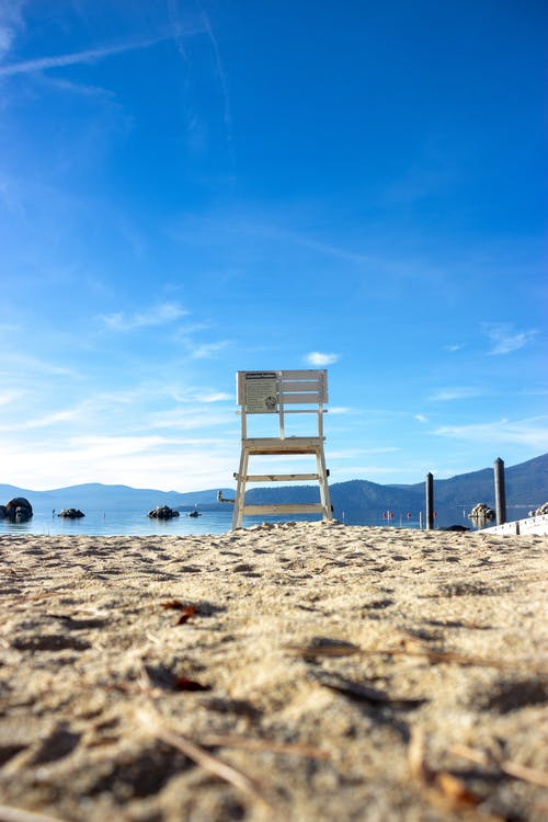 White Chair on Beige Sand