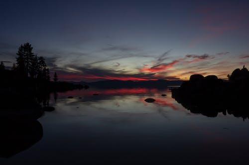 Gratis lagerfoto af aften, bagbelyst, hav, himmel