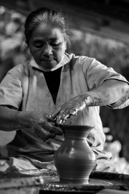 Woman Making Clay Pot Grayscale Photo