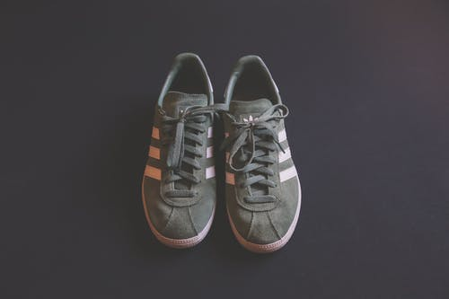 Pair of Gray Adidas Plimsolls
