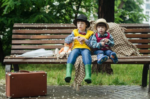 Two Kids Sitting on Brown Bench