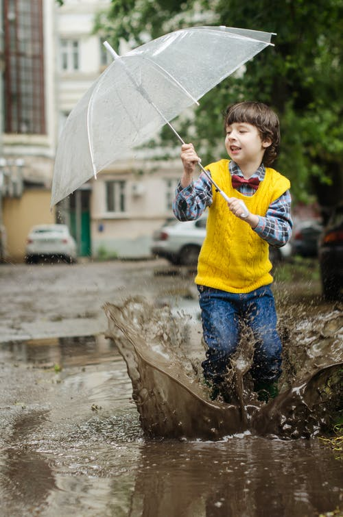 Boy Holding Clear Umbrella