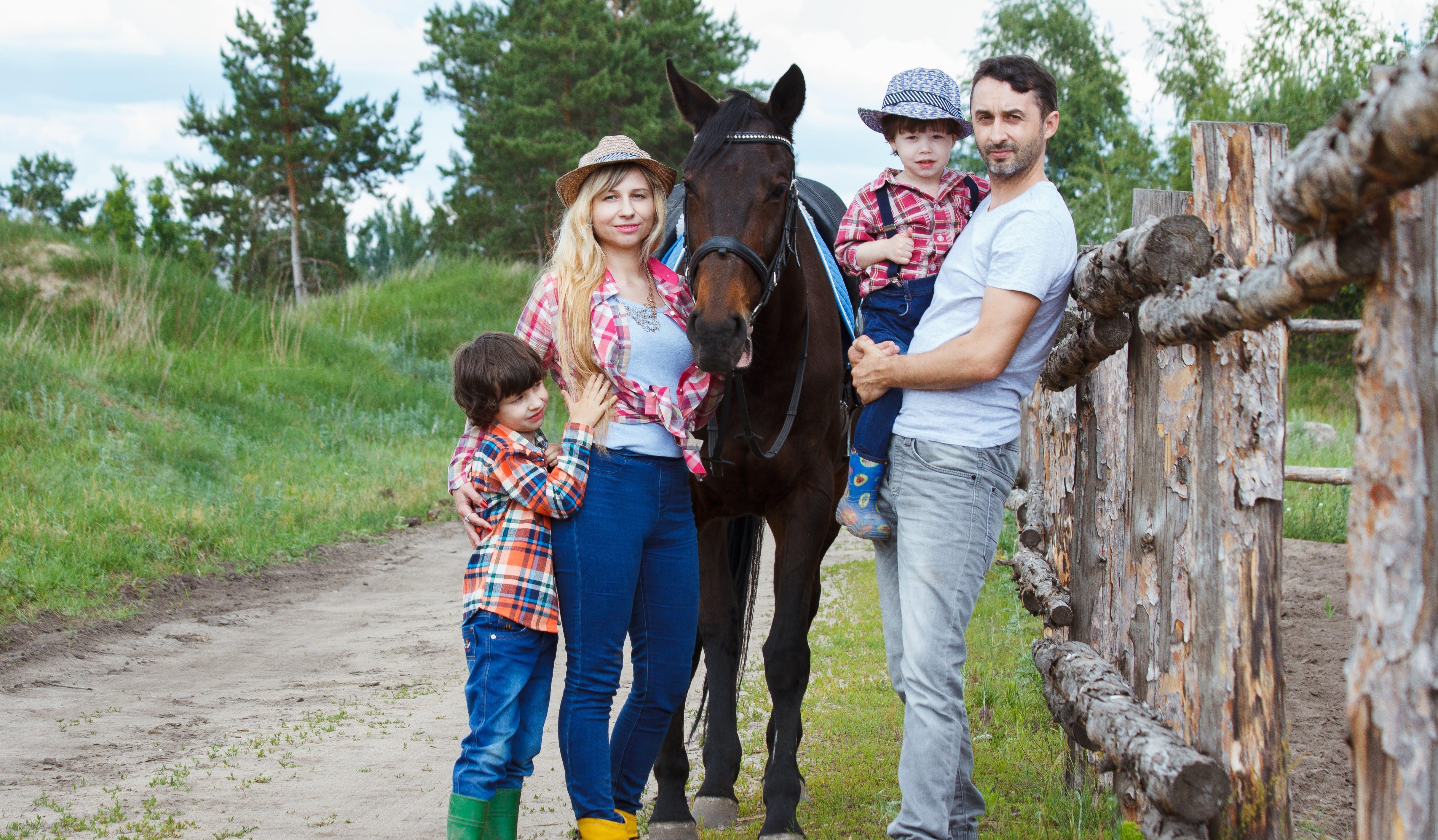 Family Standing Beside Horse