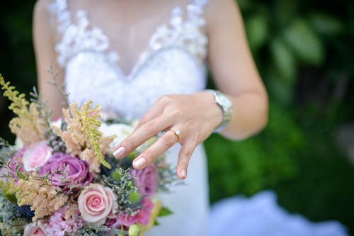 Bride Holding Pink Roses Bouquet