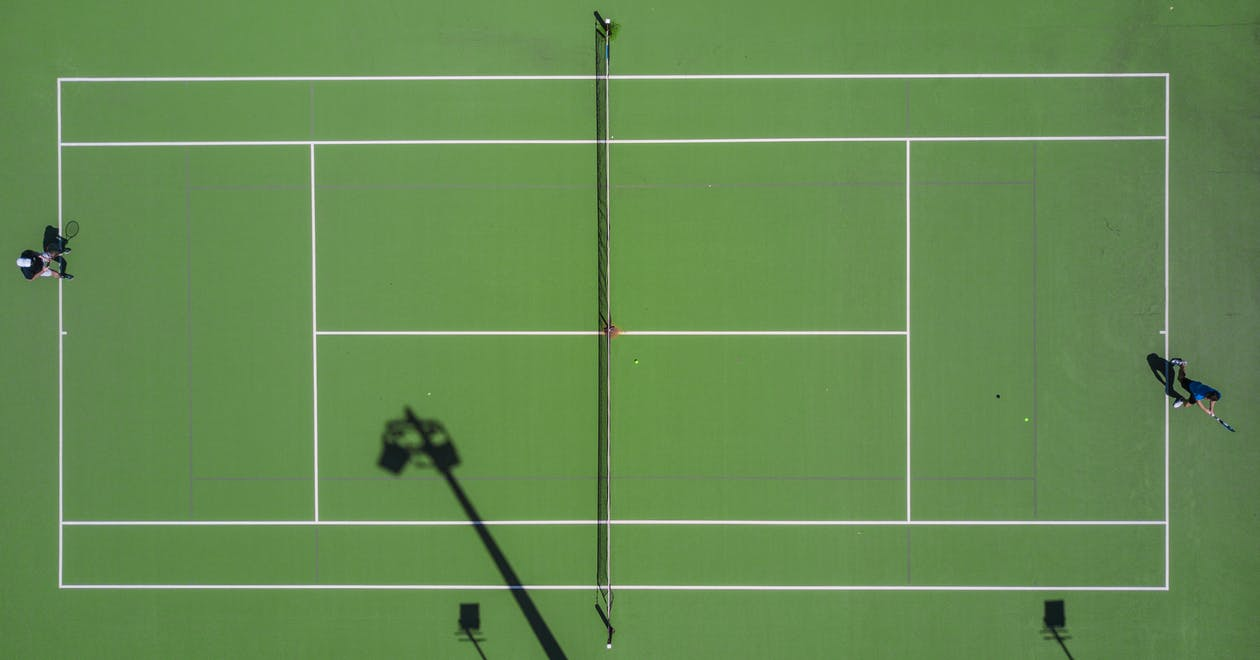 Two Person Playing Tennis