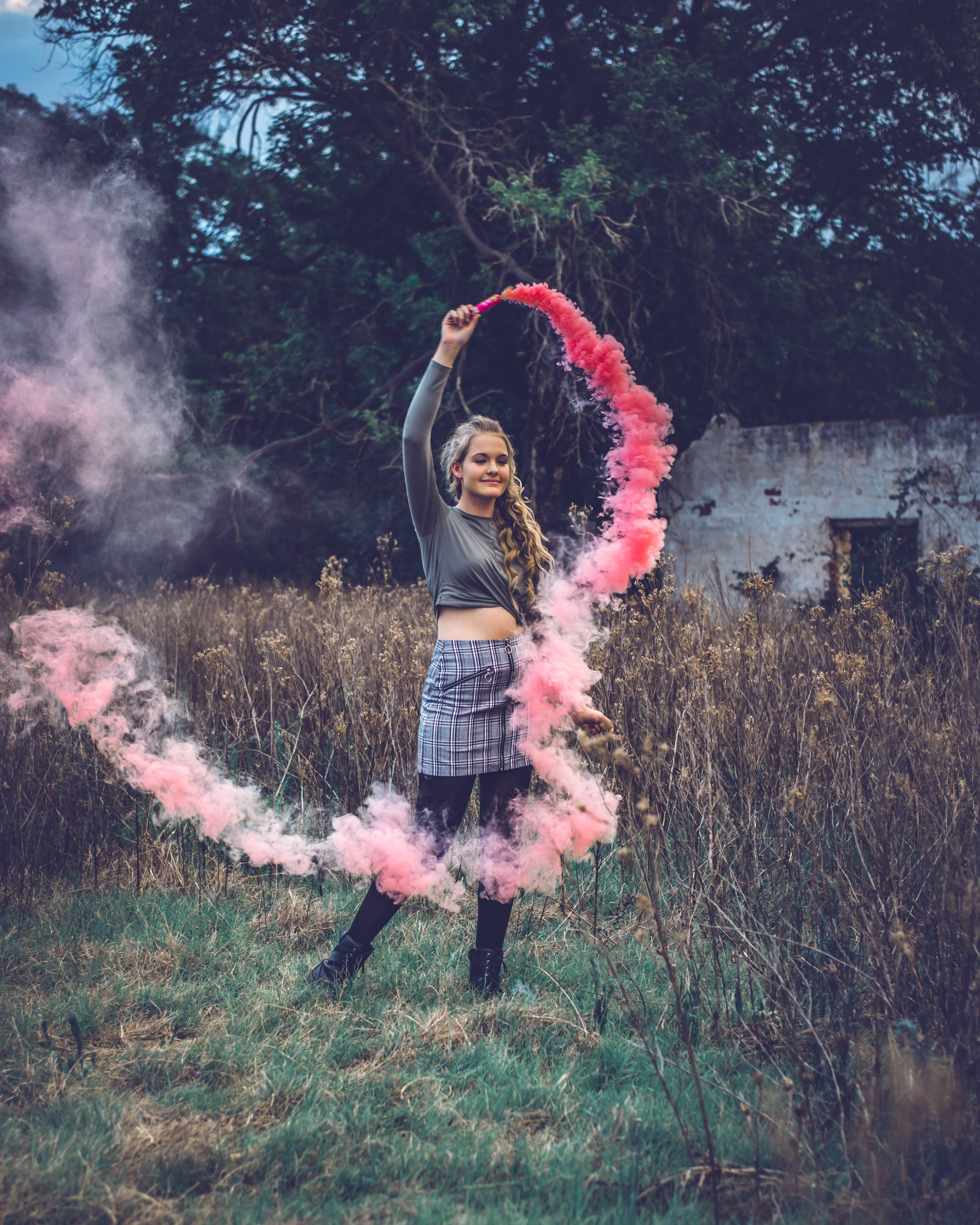 Woman Holding Pink Smoke Bomb