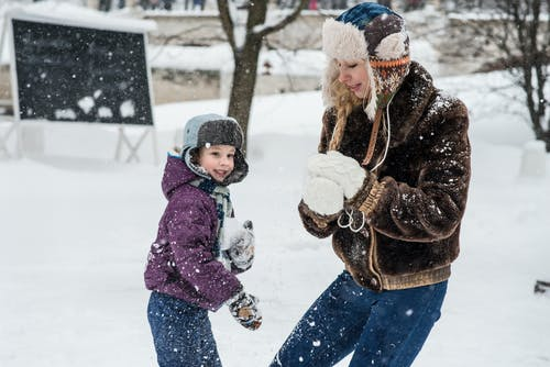 Woman and Child Playing in Snow
