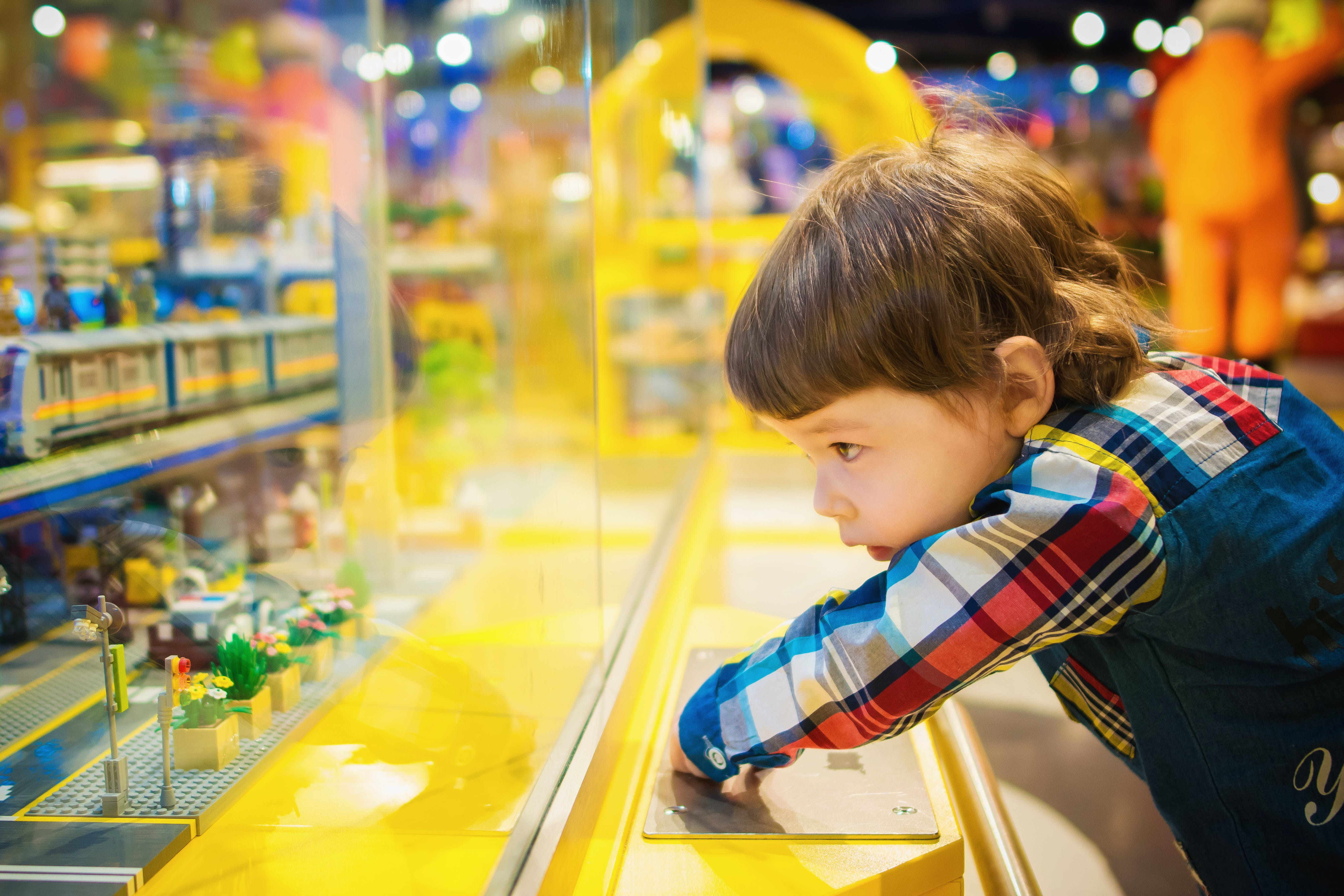 Selective Focus Photography of Toddler in Front of Glass