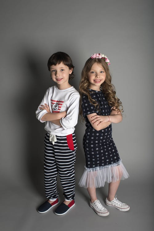 Two Boy and Girl Standing Wearing Clothe