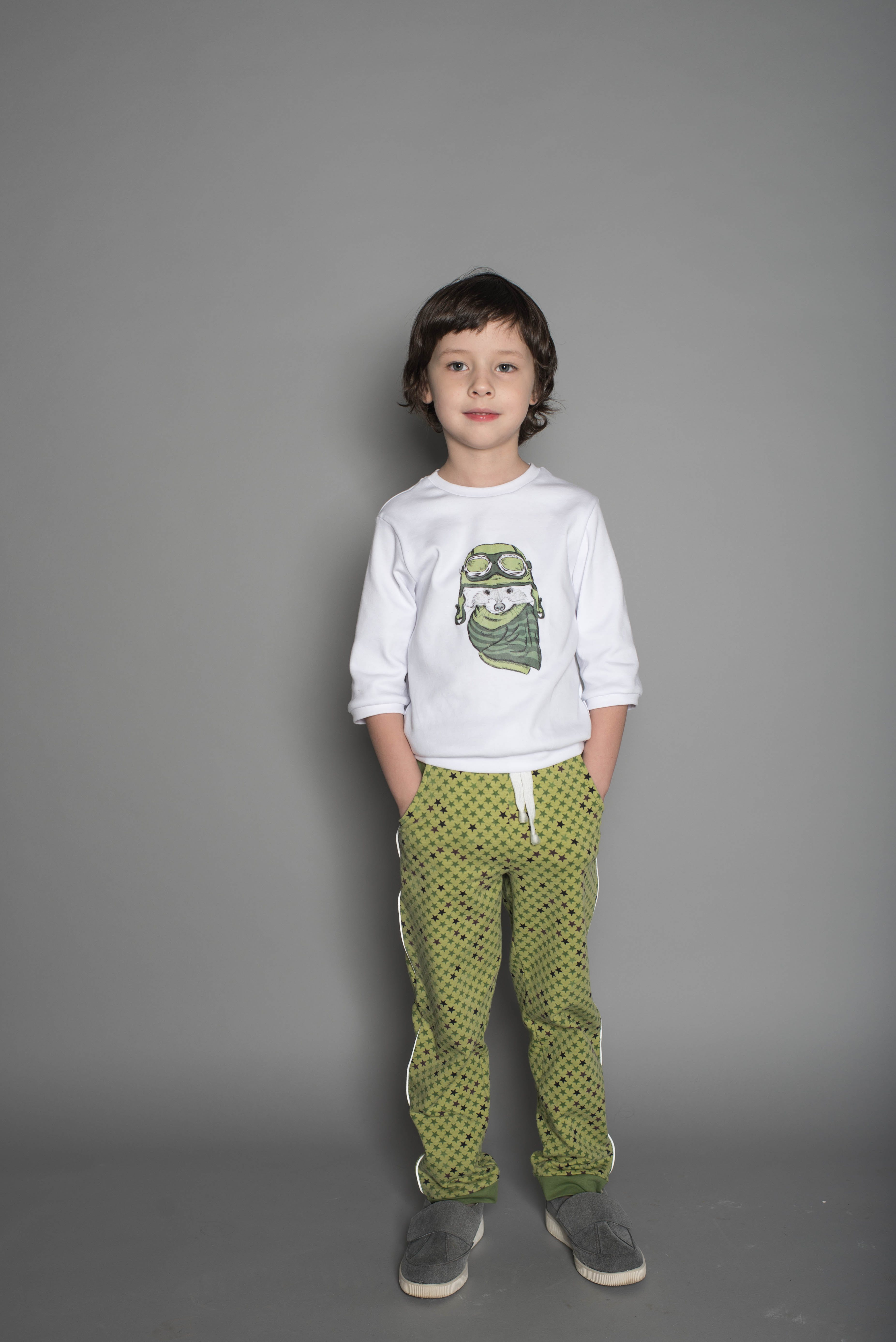 Boy Wearing White and Green T-shirt and Green Pants