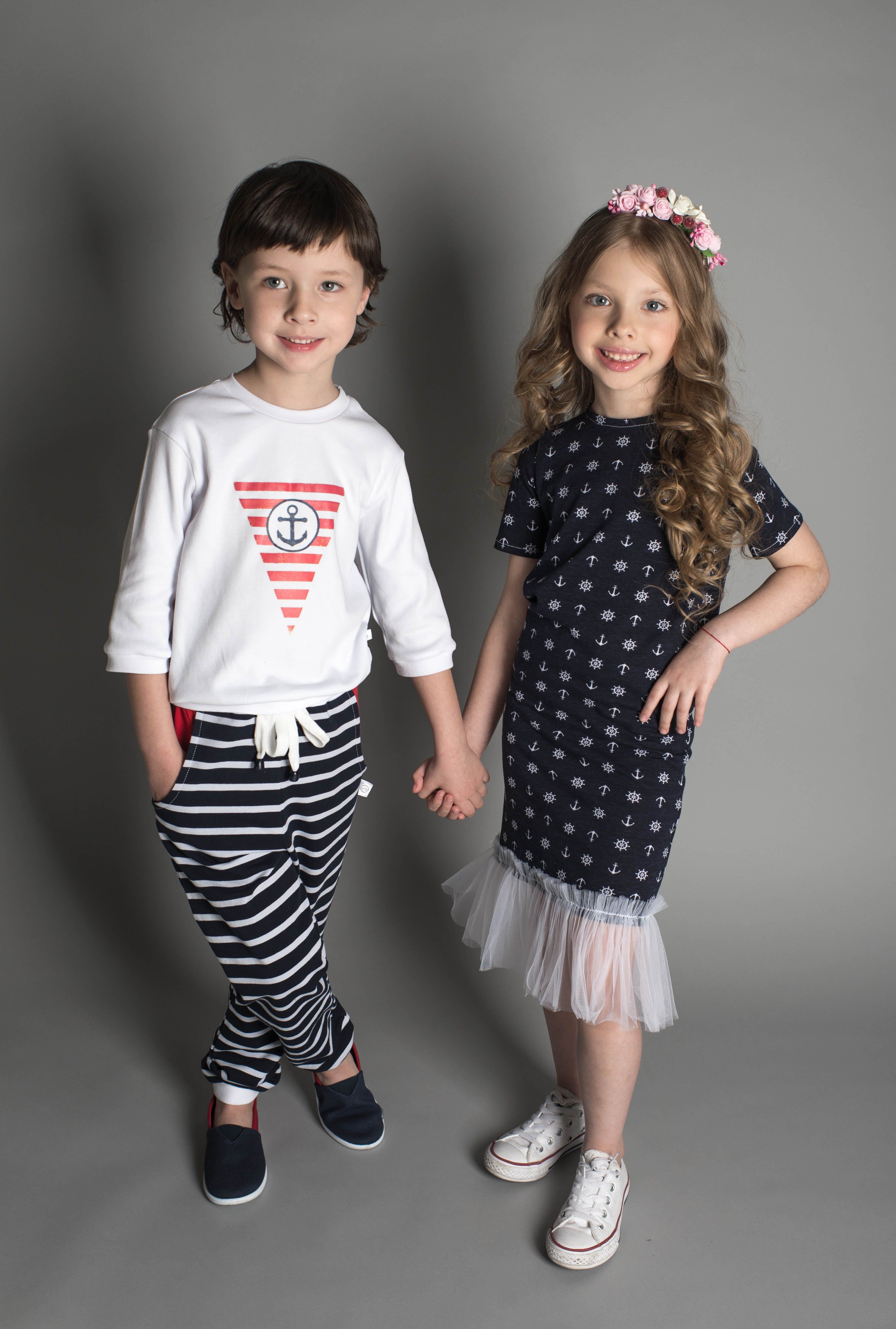 Boy and Girl Taking Photo While Holding Hands