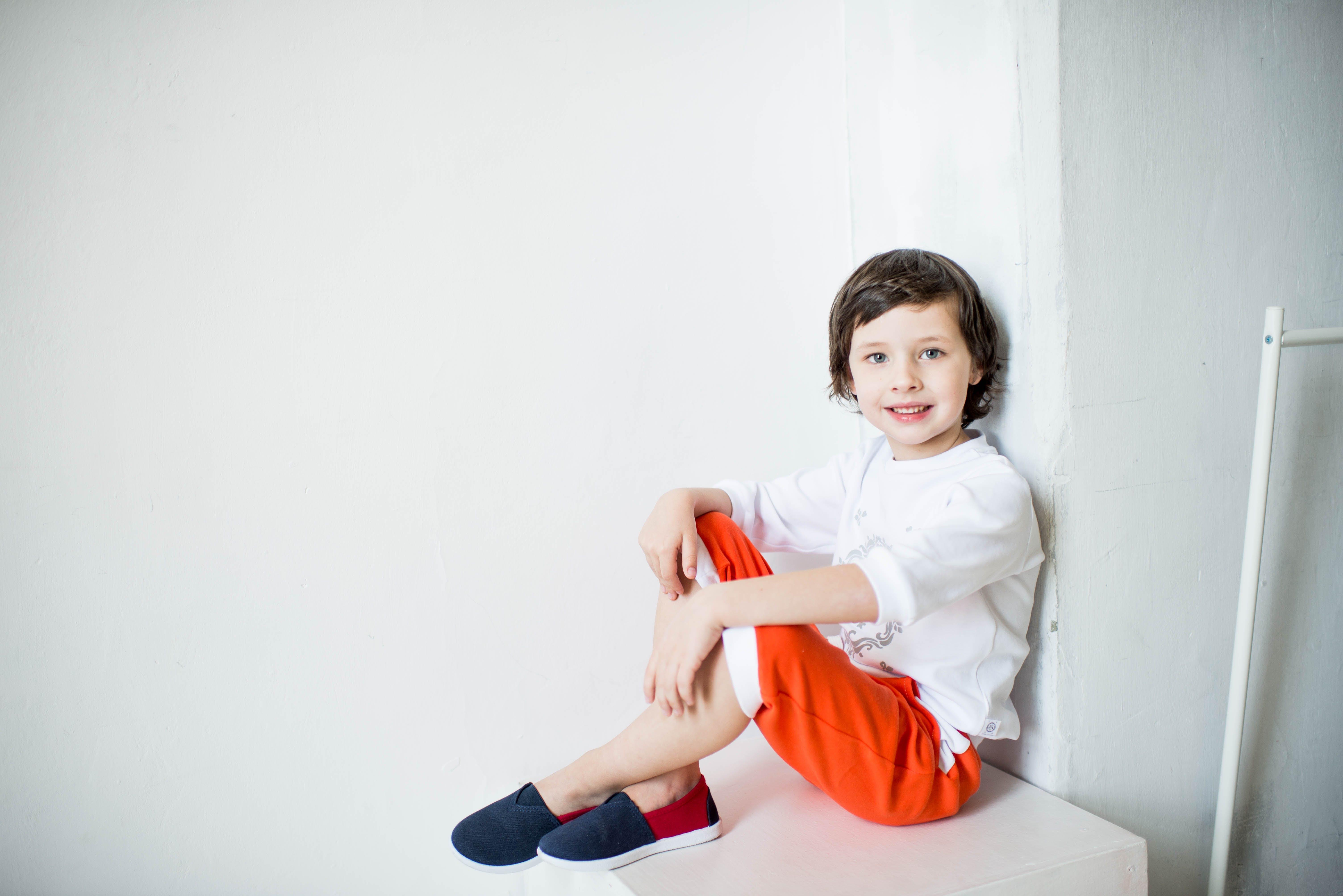 Photo of Smiling Boy Sitting