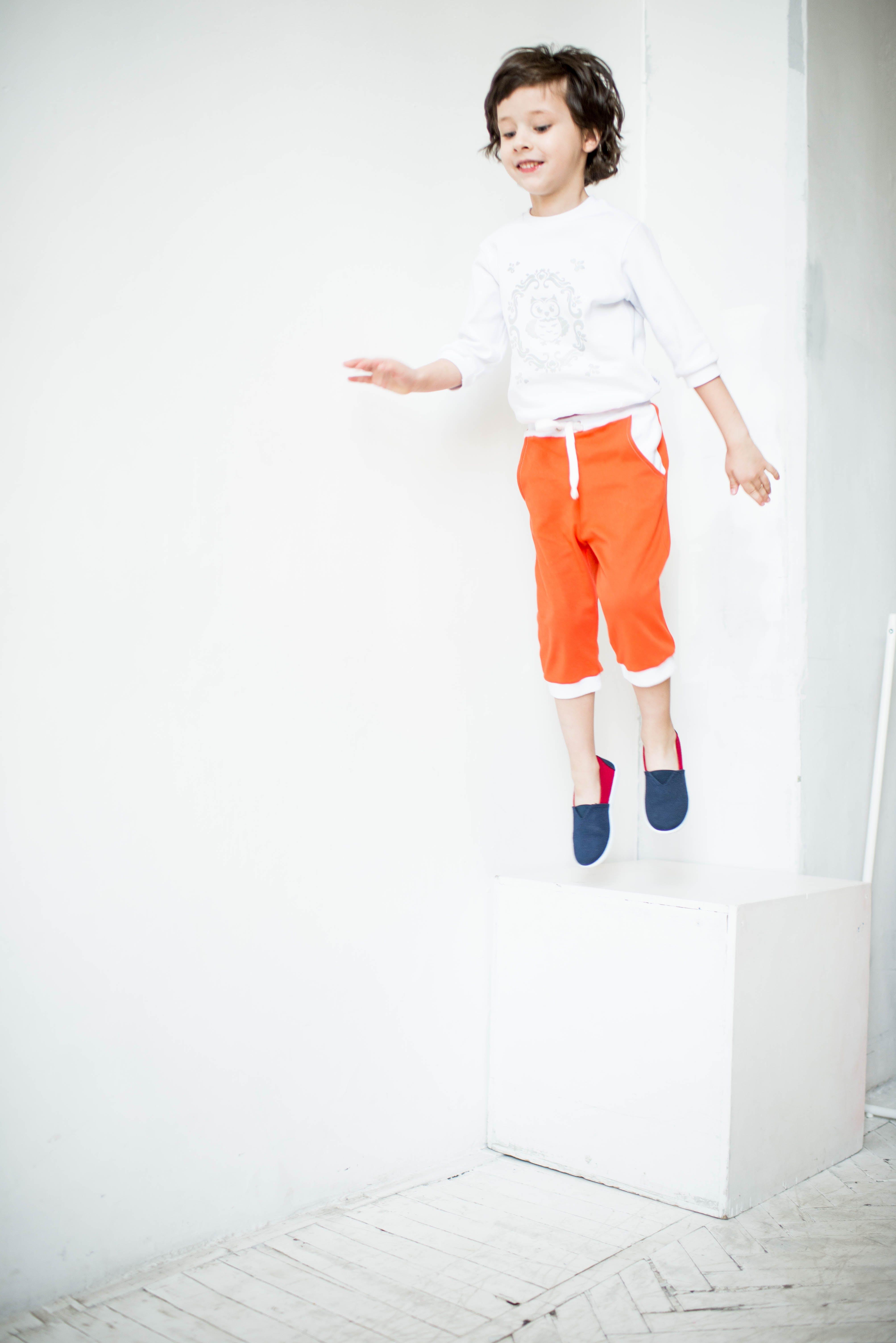 Boy Jumping Near Wall