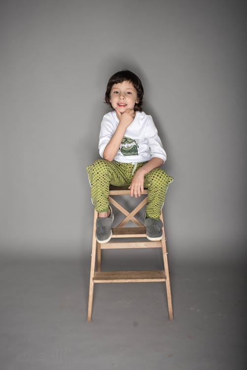 Photo of Boy Sitting On Chair