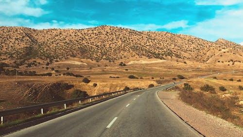 Бесплатное стоковое фото с асфальт, гора, дневной свет, дорога
