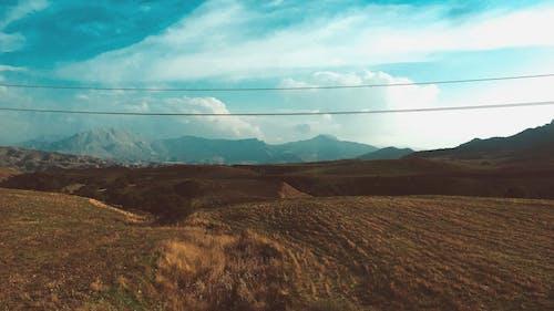 Darmowe zdjęcie z galerii z chmury, droga, góra, gospodarstwo