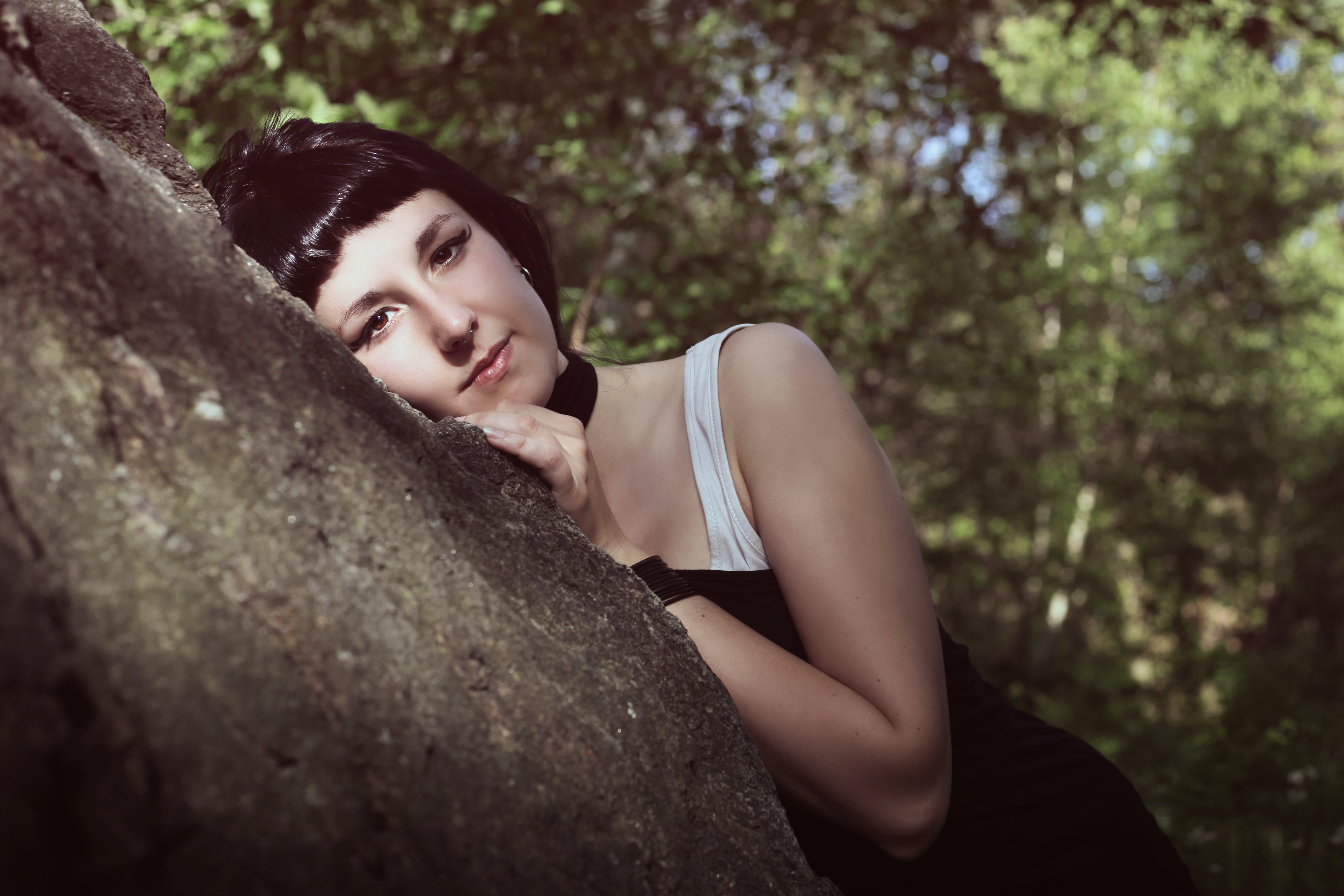 Selective Focus Photography of Woman Leaning on Tree