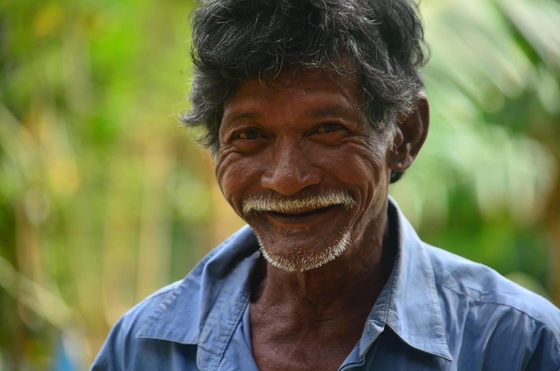 Smiling Man Wearing Blue Collared Shirt