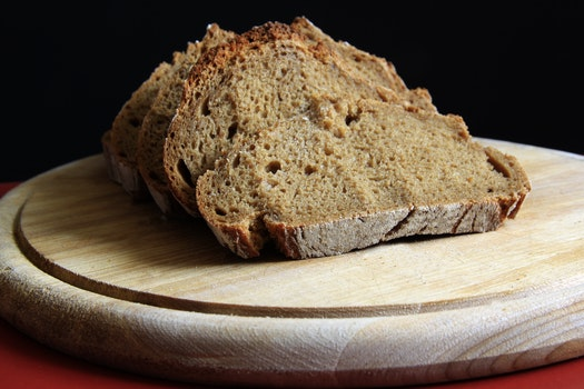 Brown Bread on Round Wooden Tray