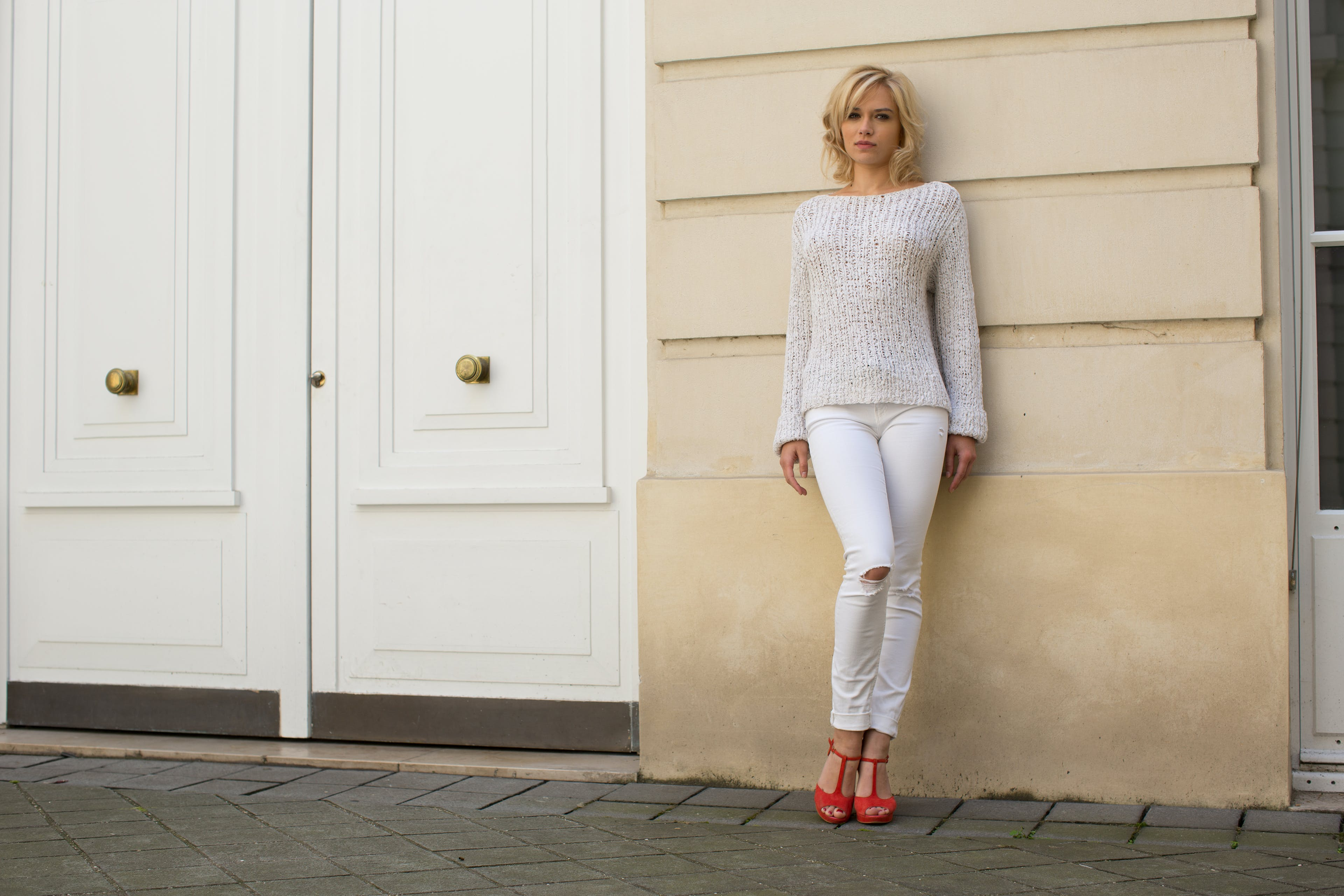 Woman in  casual wear Leaning on Wall