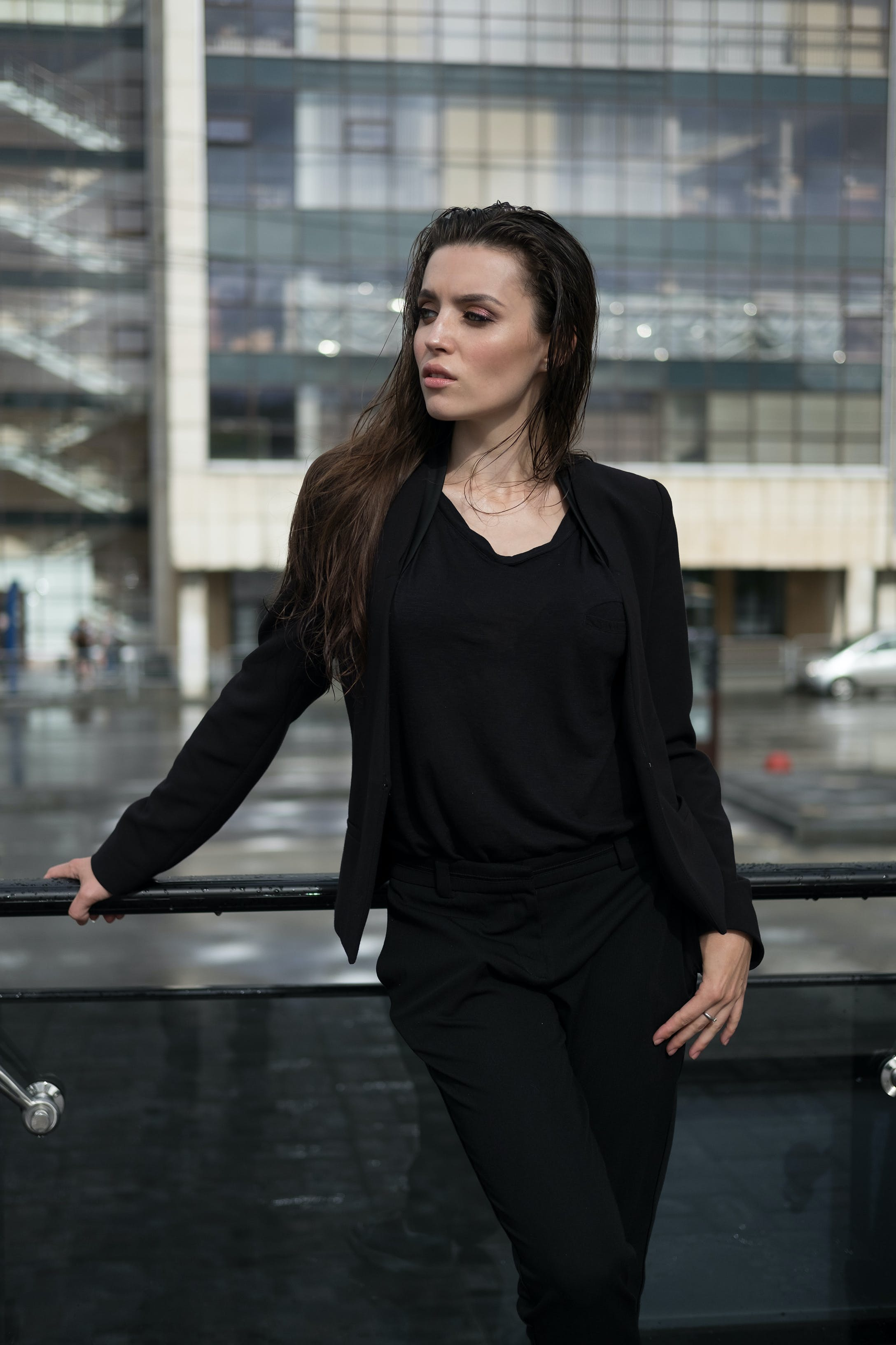 Woman Leaning on Black Wall