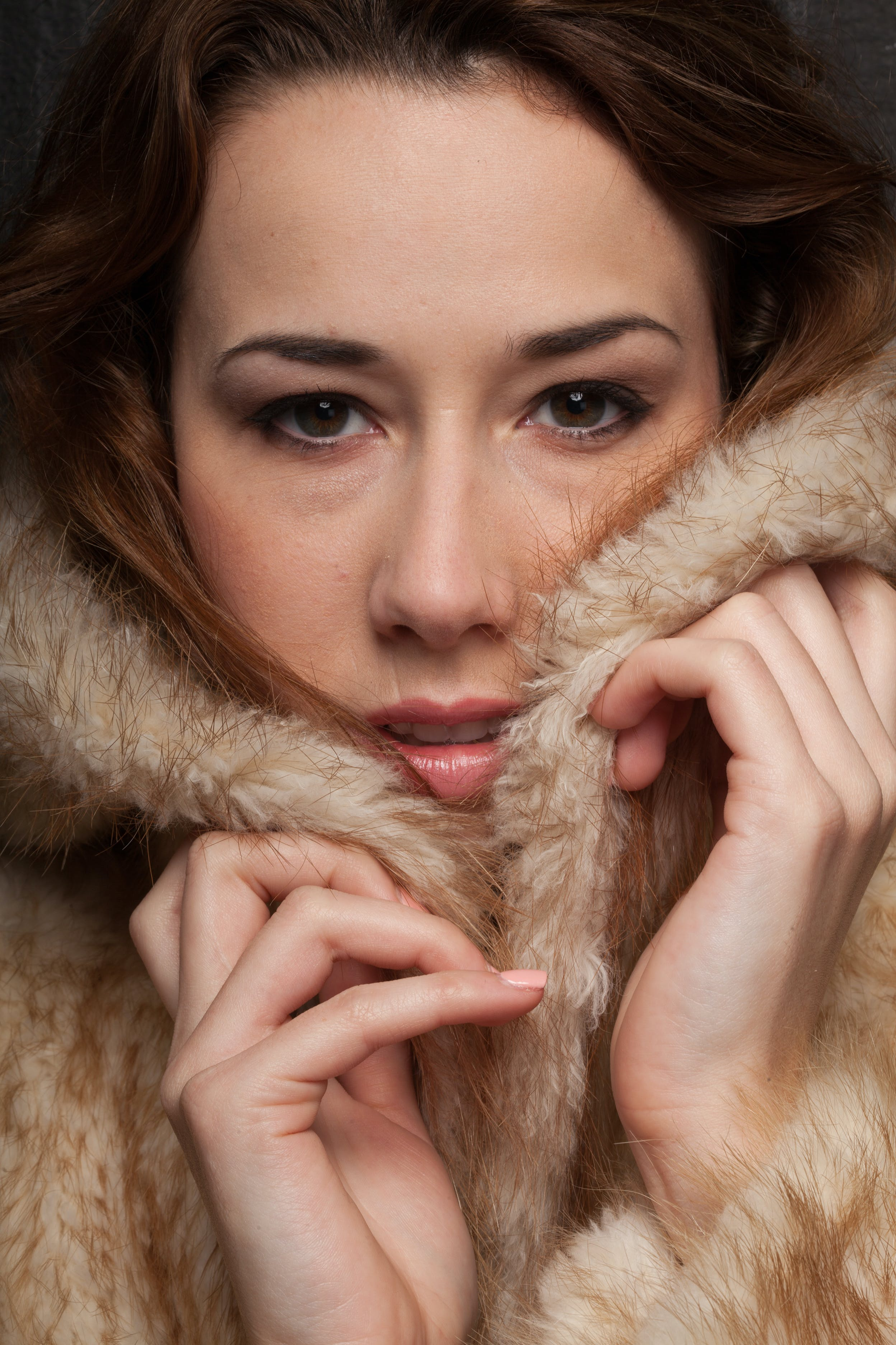 Photo of Woman Covered With Brown Fur Coat