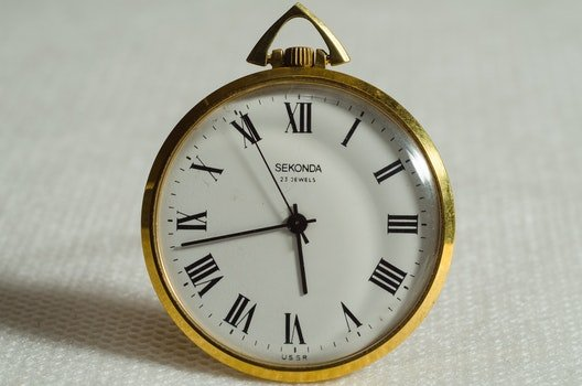 Brass Pocket Watch Pointing at 5 43