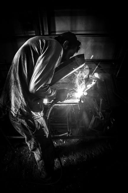 Greyscale Photo of Person Having Welding · Free Stock Photo
