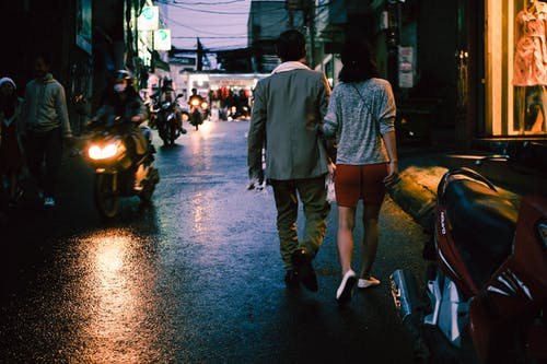 Man and Woman Walking on Street