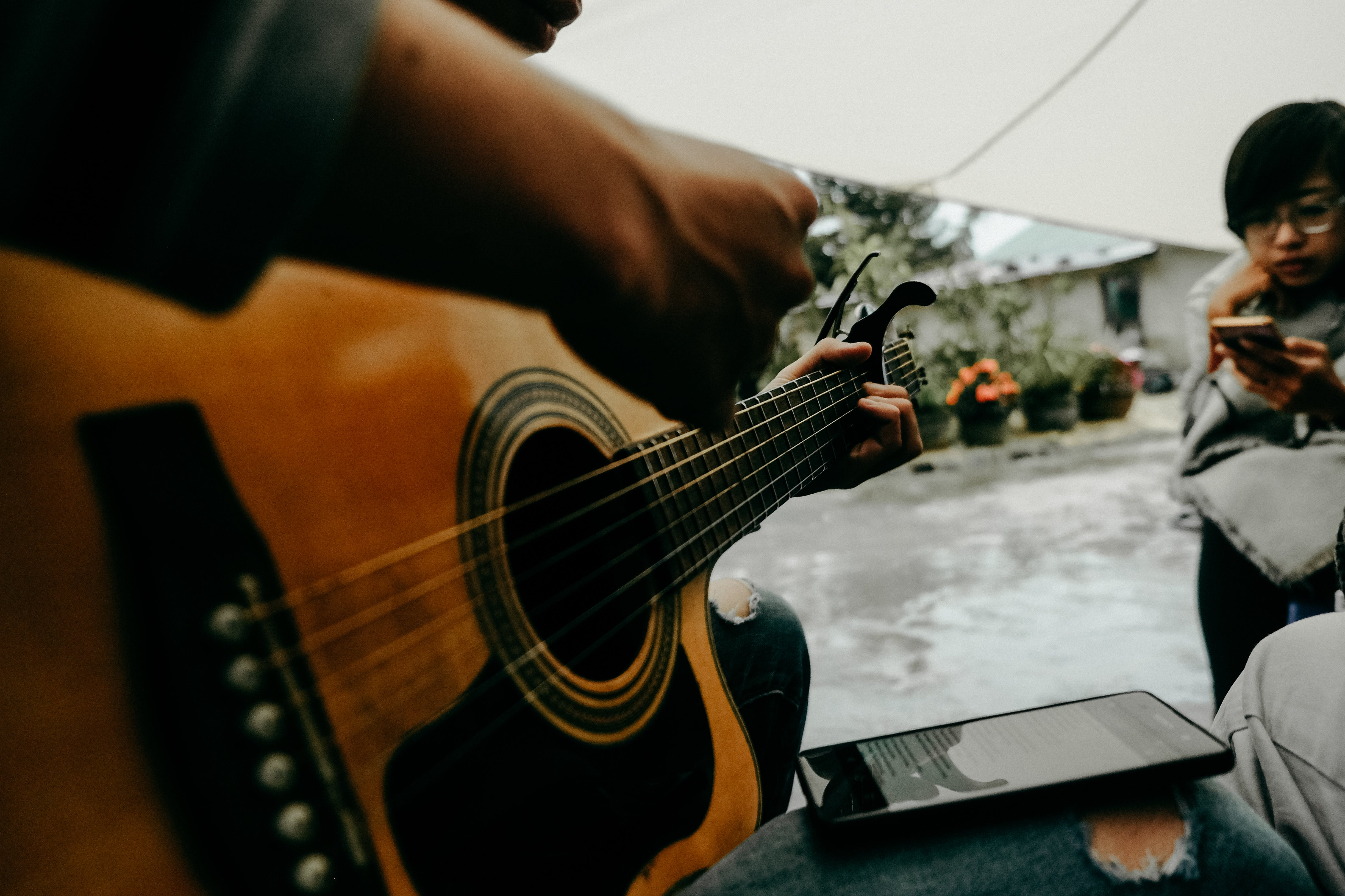 Photo of Person Playing Guitar